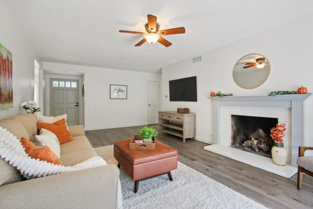 Rustic Gray floors white walls and fireplace living room Orange Ivory Leather